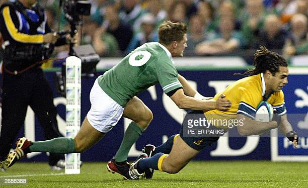 George Smith of Australia scores a try as Ireland's Ronan O'Gara tackles him in their Group A game in the Rugby World Cup 2003 at the Telstra Dome in...