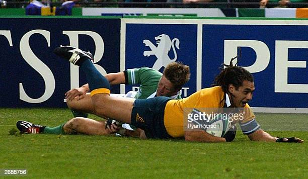 George Smith of Australia scores a try during the Rugby World Cup Pool A match between Australia and Ireland at Telstra Dome November 1, 2003 in...