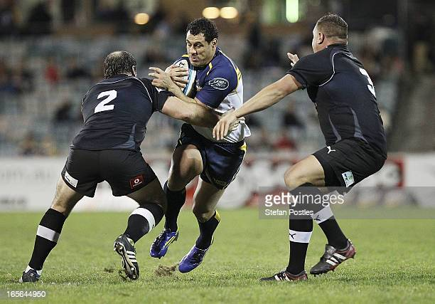 George Smith of the Brumbies is tackled during the round eight Super Rugby match between the Brumbies and the Kings at Canberra Stadium on April 5,...
