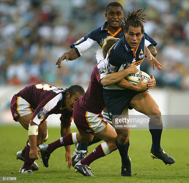 George Smith of the Brumbies makes a break during the round six Tooheys New Super 12 Rugby between the ACT Brumbies and the Queensland Reds played at...