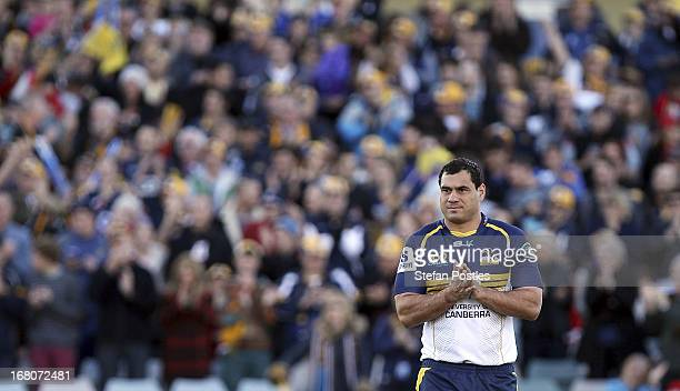 George Smith of the Brumbies runs out for his 137th match for the Brumbies prior to the round 12 Super Rugby match between the Brumbies and the...