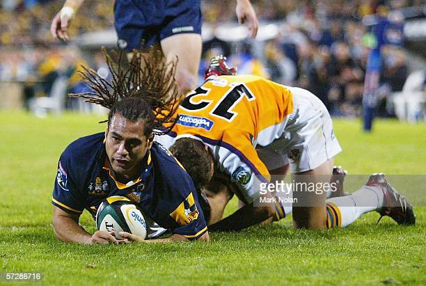George Smith of the Brumbies scores during the round nine Super 14 match between the Brumbies and the Cheetahs played at Canberra Stadium on April 8,...