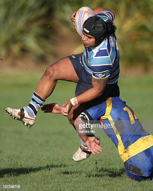 George Smith of the Leopards is tackled during the Fox Memorial Championship match between the Otahuhu Leopards and Howick Hornets at Paparoa Park...