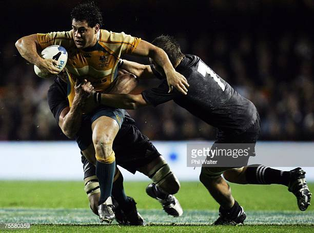 George Smith of the Wallabies is tackled by Richie McCaw of the All Blacks during the 2007 Tri Nations series match between New Zealand and Australia...