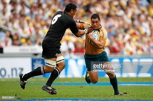George Smith of the Wallabies is tackled during the Bledisloe Cup match between the Australian Wallabies and the New Zealand All Blacks at Hong Kong...