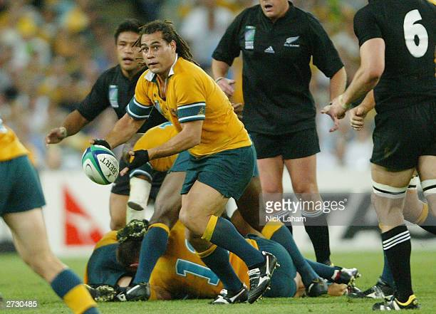 George Smith of the Wallabies passes out during the Rugby World Cup Semi-Final match between Australia and New Zealand at Telstra Stadium November...