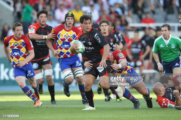 George Smith of Toulon powers forward during the Heineken Cup quarter final match between Perpignan and Toulon at the Olympic Stadium on April 9 2011...