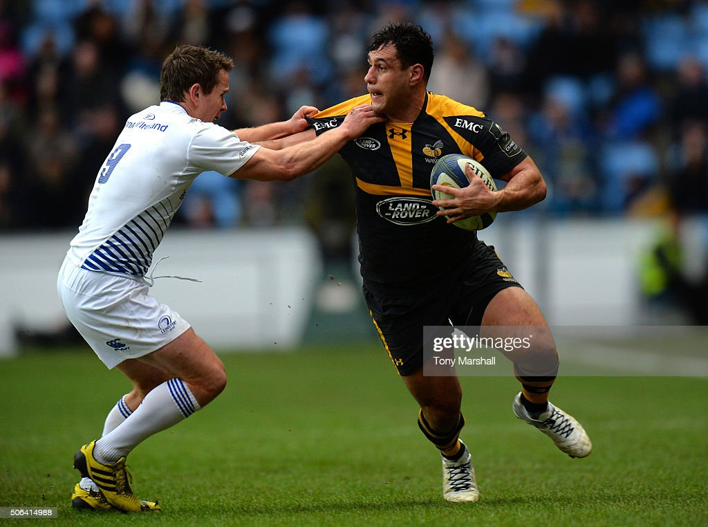 George Smith of Wasps is tackled by Eoin Reddan of Leinster Rugby during the European Rugby Champions Cup match between Wasps and Leinster Rugby at Ricoh Arena on January 23, 2016 in Coventry, England.
