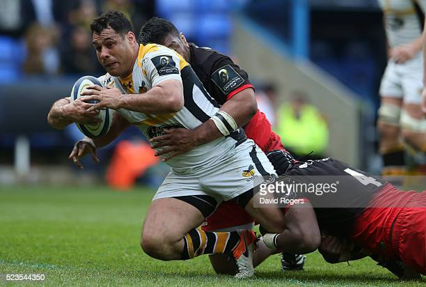 George Smith of Wasps is tackled by Mako Vunipola and Maro Itoje during the European Rugby Champions Cup semi final match between Saracens and Wasps...