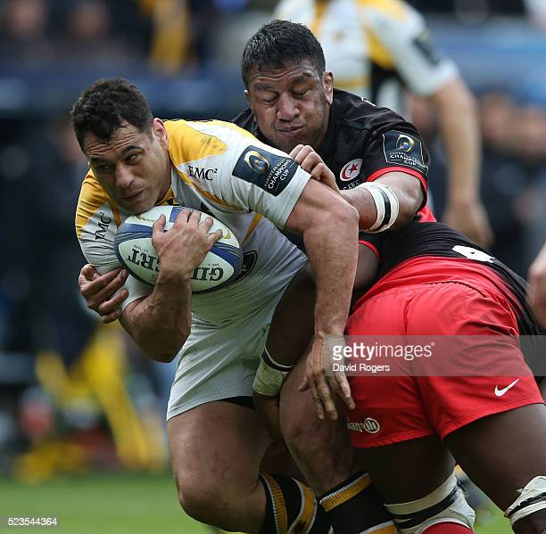 George Smith of Wasps is tackled by Mako Vunipola during the European Rugby Champions Cup semi final match between Saracens and Wasps at Madejski...