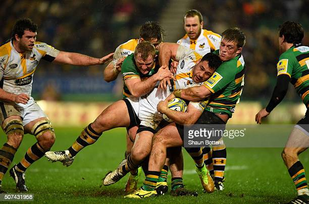 George Smith of Wasps is tackled by Mikey Haywood of Northampton Saints and Alex Waller of Northampton Saints during the Aviva Premiership match...