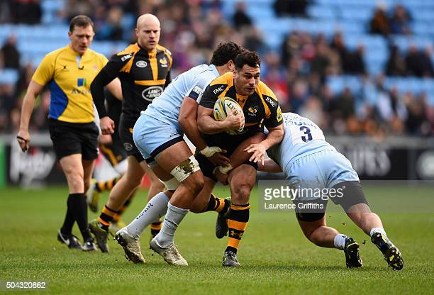 George Smith of Wasps is tackles by Nick Schonert of Worcester Warriors during the Aviva Premiership match between Wasps and Worcester Warriors at...