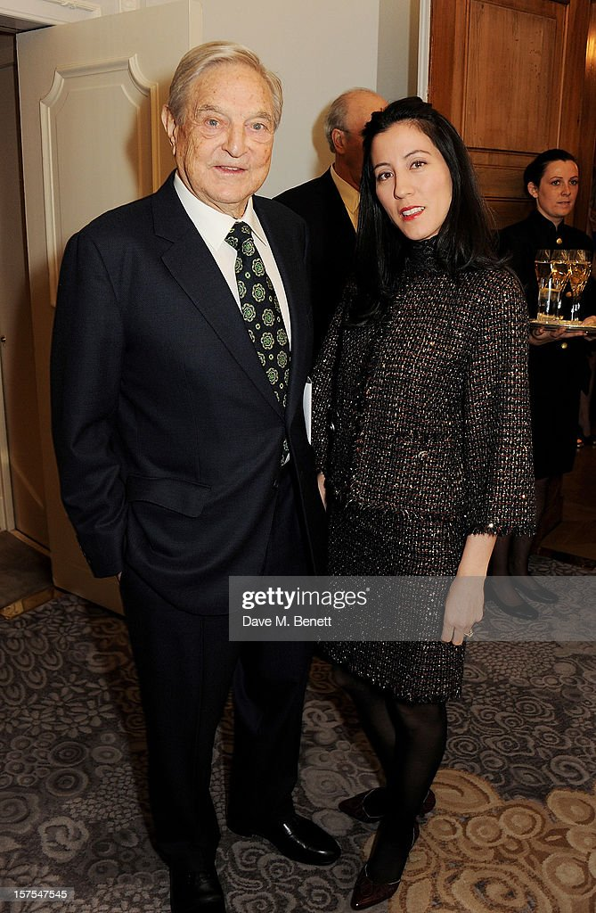 George Soros (L) and Tamika Bolton attend a cocktail reception at the 4th Fortune Forum Summit held at The Dorchester on December 4, 2012 in London, England.
