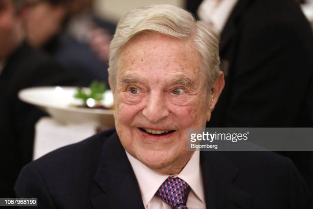 George Soros billionaire and founder of Soros Fund Management LLC smiles before speaking at an event on day three of the World Economic Forum in...
