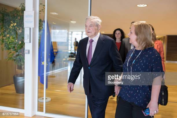 George Soros billionaire and founder of Soros Fund Management LLC center arrives ahead of a meeting with the President of the European Commission...