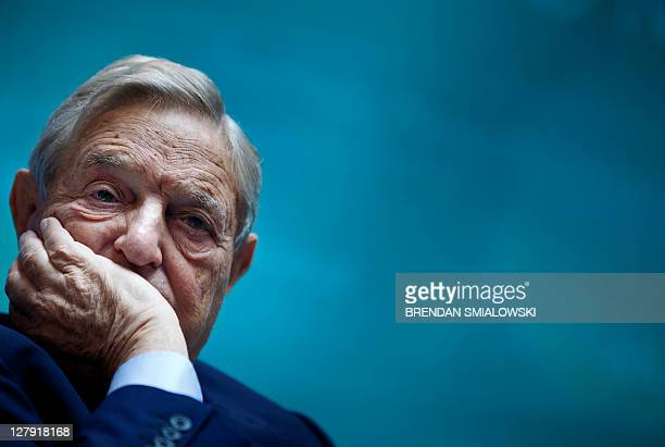 George Soros Chairman of Soros Fund Management listens during a seminar titled 'Charting A New Growth Path for the Euro Zone' at the annual...