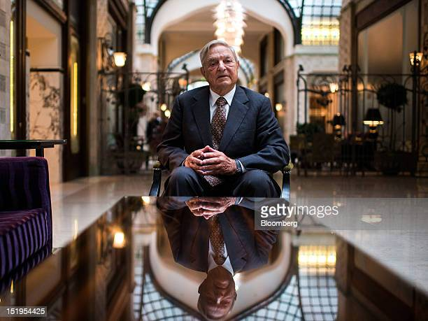 George Soros founder of Soros Fund Management LLC poses for a photograph following a Bloomberg Television interview in Budapest Hungary on Thursday...