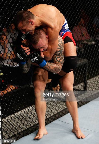 George Sotiropoulos attempts a rear choke against Ross Pearson during their lightweight fight at the UFC on FX event on December 15 2012 at Gold...