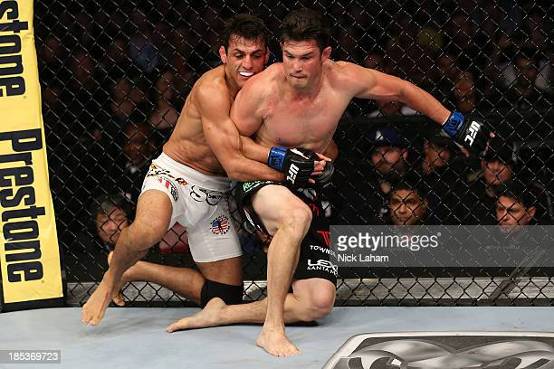 George Sotiropoulos attempts to take down KJ Noons in their UFC lightweight bout at the Toyota Center on October 19 2013 in Houston Texas