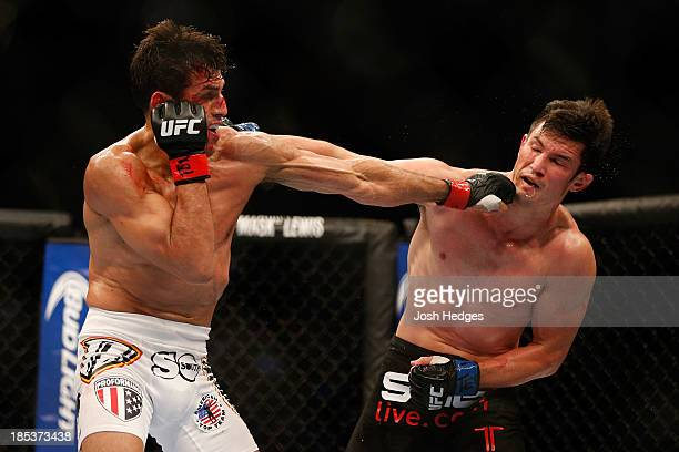 George Sotiropoulos punches KJ Noons in their UFC lightweight bout at the Toyota Center on October 19 2013 in Houston Texas
