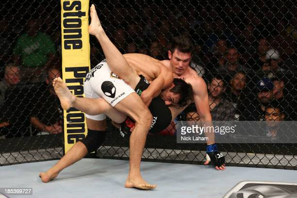 George Sotiropoulos takes down KJ Noons in their UFC lightweight bout at the Toyota Center on October 19 2013 in Houston Texas