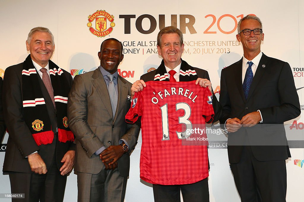 George Souris MP, Dwight Yorke, NSW Premier Barry O'Farrell and FFA CEO David Gallop pose after a press conference at Museum of Contemporary Art on December 10, 2012 in Sydney, Australia. Manchester United will play an A-League All-Stars match in Sydney on July 20, 2013.