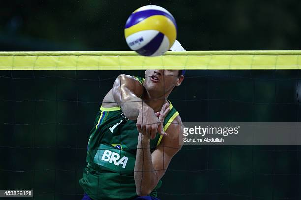 George Souto Maior Wanderley of Brazil spikes during the match against New Zealand during the Nanjing 2014 Youth Olympic Beach Volleyball at the...