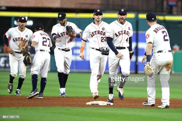 George Springer and Alex Bregman of the Houston Astros celebrates with their teammates after defeating the New York Yankees with a score of 7 to 2 in...