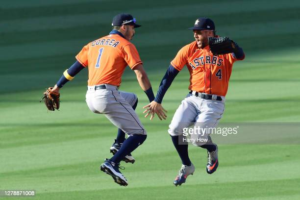 George Springer and Carlos Correa of the Houston Astros celebrate a 5-2 win against the Oakland Athletics in Game Two of the American League Division...