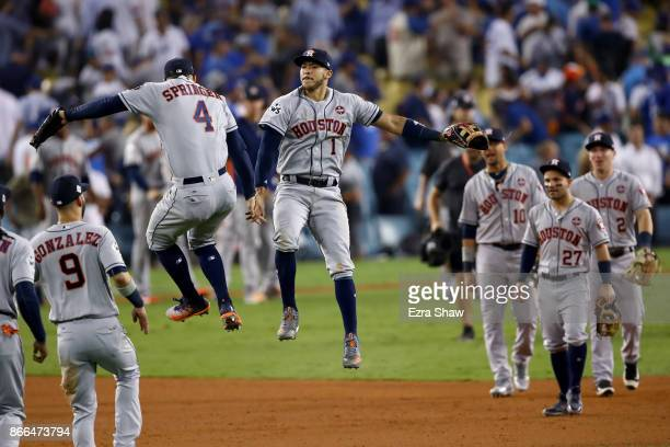 George Springer and Carlos Correa of the Houston Astros celebrate after defeating the Los Angeles Dodgers 76 in eleven innings to win game two of the...