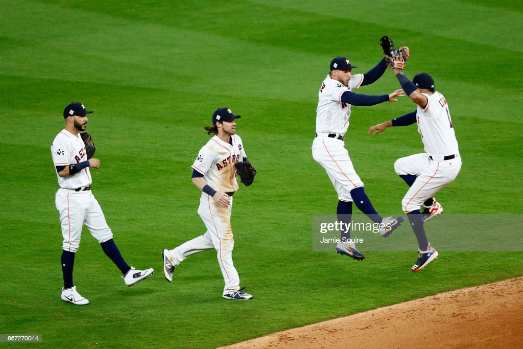 George Springer #4 and Carlos Correa #1 of the Houston Astros celebrate after defeating the Los Angeles Dodgers in game three of the 2017 World Series at Minute Maid Park on October 27, 2017 in Houston, Texas. The Astros defeated the Dodgers 5-3.