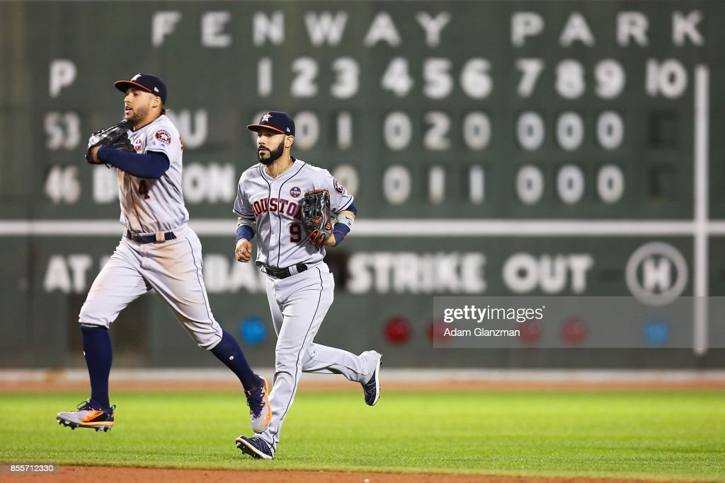 George Springer #4 and Marwin Gonzalez #9 of the Houston Astros react after a victory over the Boston Red Sox at Fenway Park on September 29, 2017 in Boston, Massachusetts.
