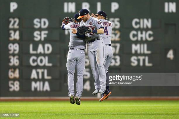 George Springer Marwin Gonzalez and Derek Fisher of the Houston Astros celebrate after a victory over the Boston Red Sox at Fenway Park on September...