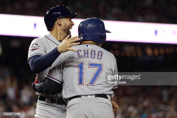 George Springer of the Houston Astros and the American League and ShinSoo Choo of the Texas Rangers and the American League celebrate after scoring...