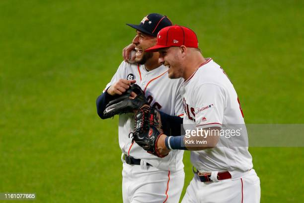 George Springer of the Houston Astros and the American League talks with Mike Trout of the Los Angeles Angels of Anaheim and the American League...