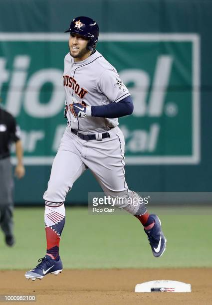 George Springer of the Houston Astros and the American League celebrates while rounding the bases after hitting a solo home run in the tenth inning...