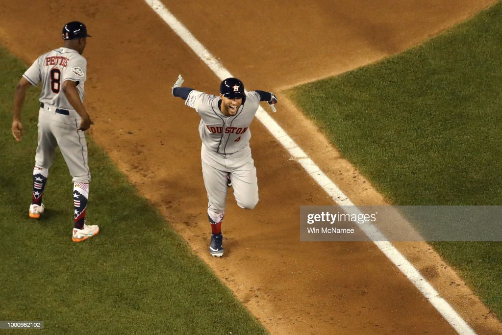 George Springer #4 of the Houston Astros and the American League celebrates while rounding the bases after hitting a solo home run in the tenth inning against the National League during the 89th MLB All-Star Game, presented by Mastercard at Nationals Park on July 17, 2018 in Washington, DC.