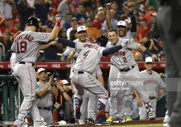 George Springer of the Houston Astros and the American League celebrates with teammates after hitting a solo home run in the tenth inning against the...