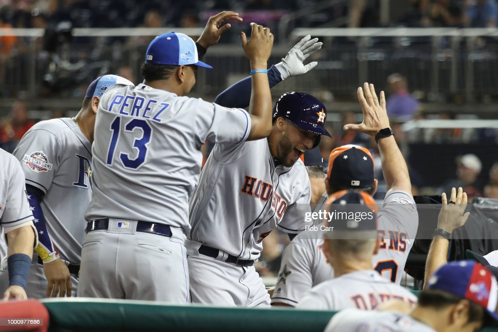 George Springer #4 of the Houston Astros and the American League celebrates with teammates after hitting a solo home run in the tenth inning against the National League during the 89th MLB All-Star Game, presented by Mastercard at Nationals Park on July 17, 2018 in Washington, DC.