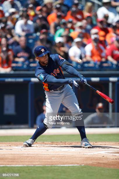 George Springer of the Houston Astros bats during a spring training game against the Washington Nationals at FITTEAM Ballpark on March 15 2018 in...
