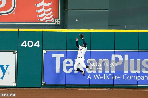 George Springer of the Houston Astros catches a pop up fly at the wall hit by Todd Frazier of the New York Yankees during the seventh inning in Game...