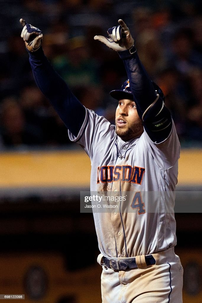 George Springer #4 of the Houston Astros celebrates after hitting a home run against the Oakland Athletics during the eighth inning at the Oakland Coliseum on June 19, 2017 in Oakland, California. The Houston Astros defeated the Oakland Athletics 4-1.