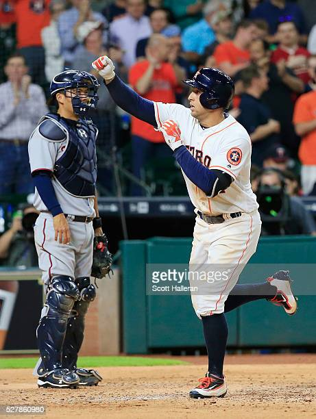 George Springer of the Houston Astros celebrates after hitting a tworun home run in the fourth inning of their game against the Minnesota Twins at...