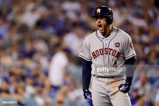 George Springer of the Houston Astros celebrates after hitting a tworun home run during the eleventh inning against the Los Angeles Dodgers in game...