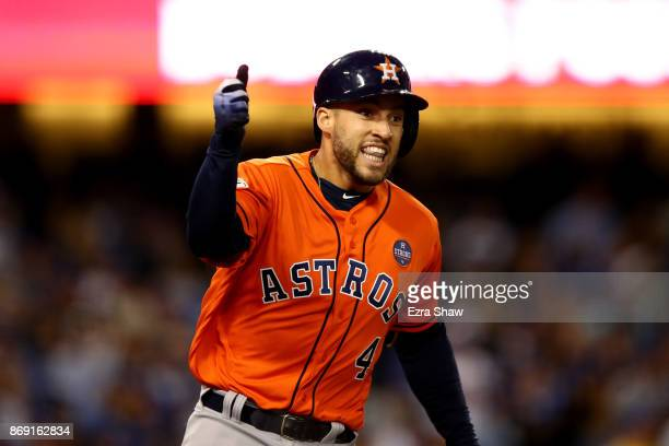 George Springer of the Houston Astros celebrates after hitting a tworun home run during the second inning against the Los Angeles Dodgers in game...