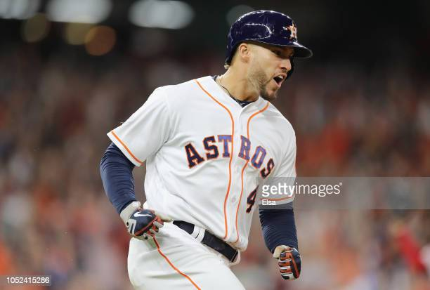 George Springer of the Houston Astros celebrates after hitting a solo home run in the third inning against the Boston Red Sox during Game Four of the...
