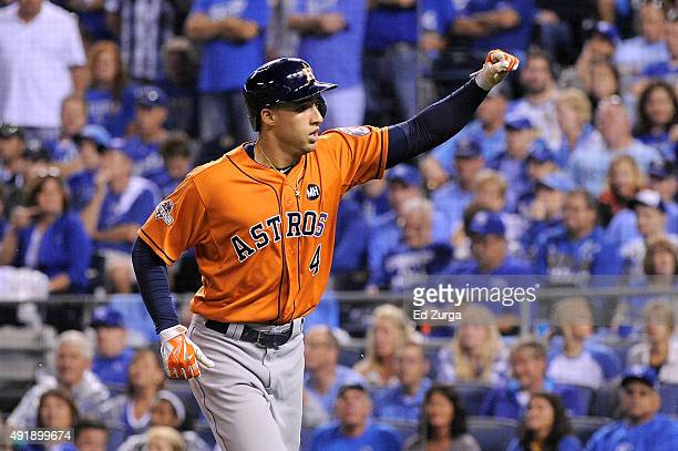 George Springer of the Houston Astros celebrates after hitting a solo home run in the fifth inning against the Kansas City Royals during game one of...
