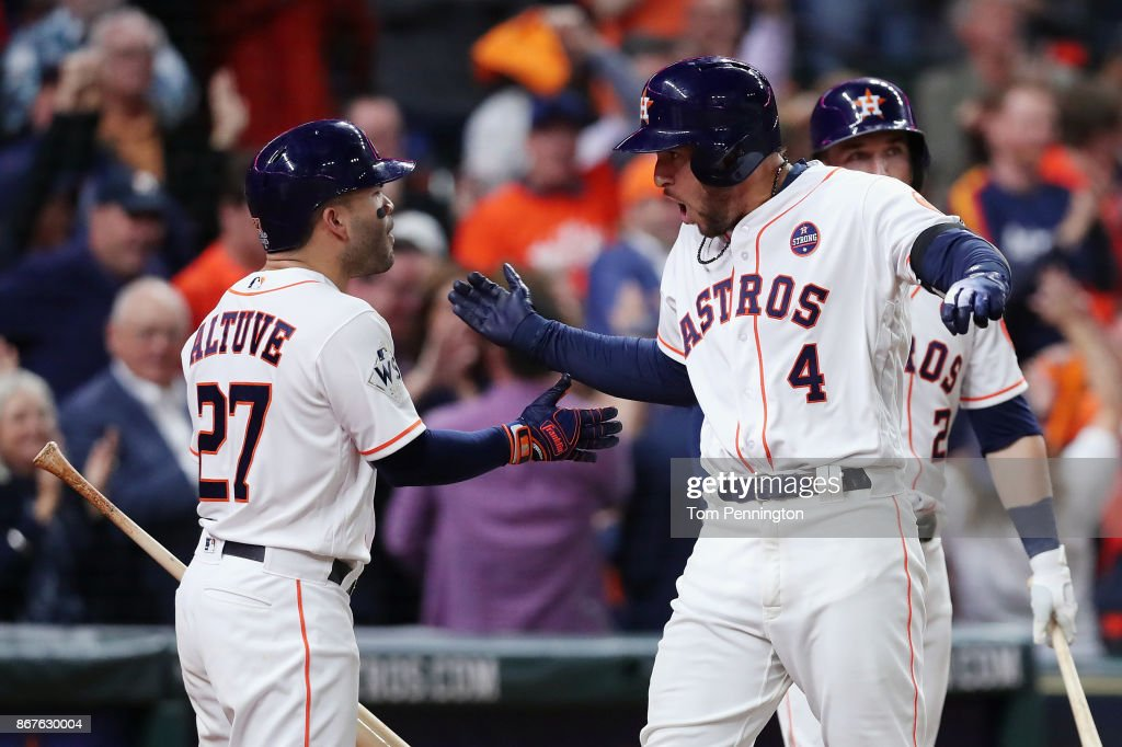 George Springer #4 of the Houston Astros celebrates after hitting a solo home run during the sixth inning against the Los Angeles Dodgers in game four of the 2017 World Series at Minute Maid Park on October 28, 2017 in Houston, Texas.