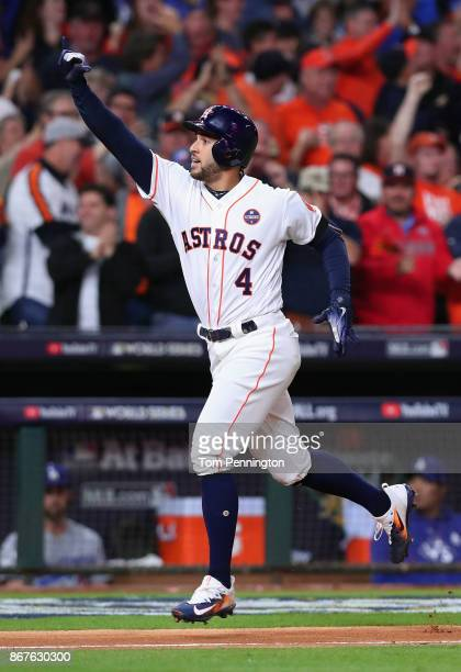 George Springer of the Houston Astros celebrates after hitting a solo home run during the sixth inning against the Los Angeles Dodgers in game four...