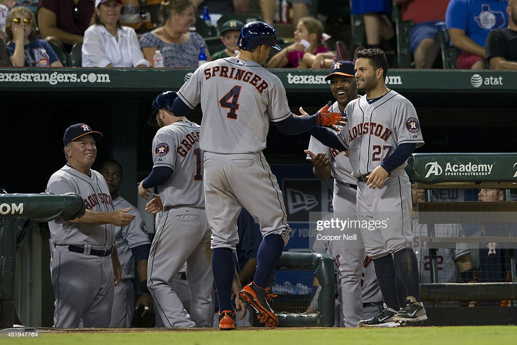 George Springer #4 of the Houston Astros celebrates after hitting a two run home run during the seventh inning against the Texas Rangers on July 9, 2014 at Globe Life Park in Arlington in Arlington, Texas.